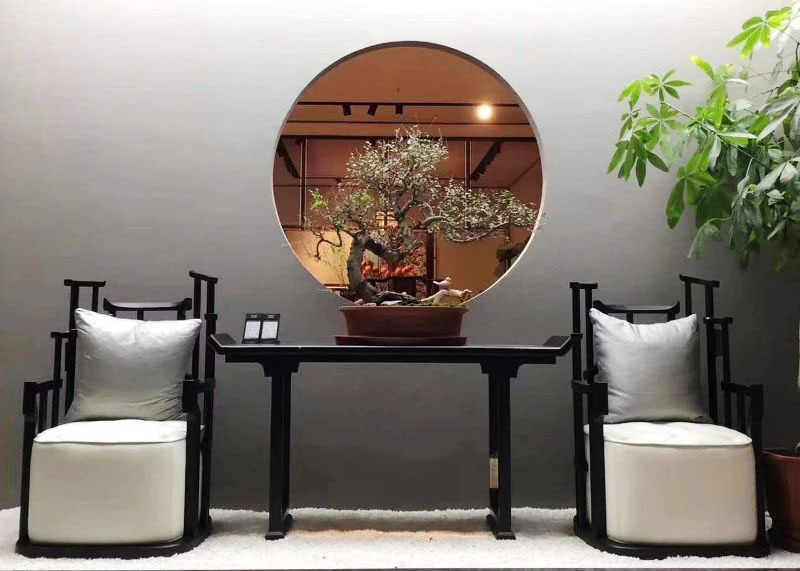 oriental casa - five home decor refresh tips for spring bonsai decor - A bonsai plants sits in between two Chinese chairs.